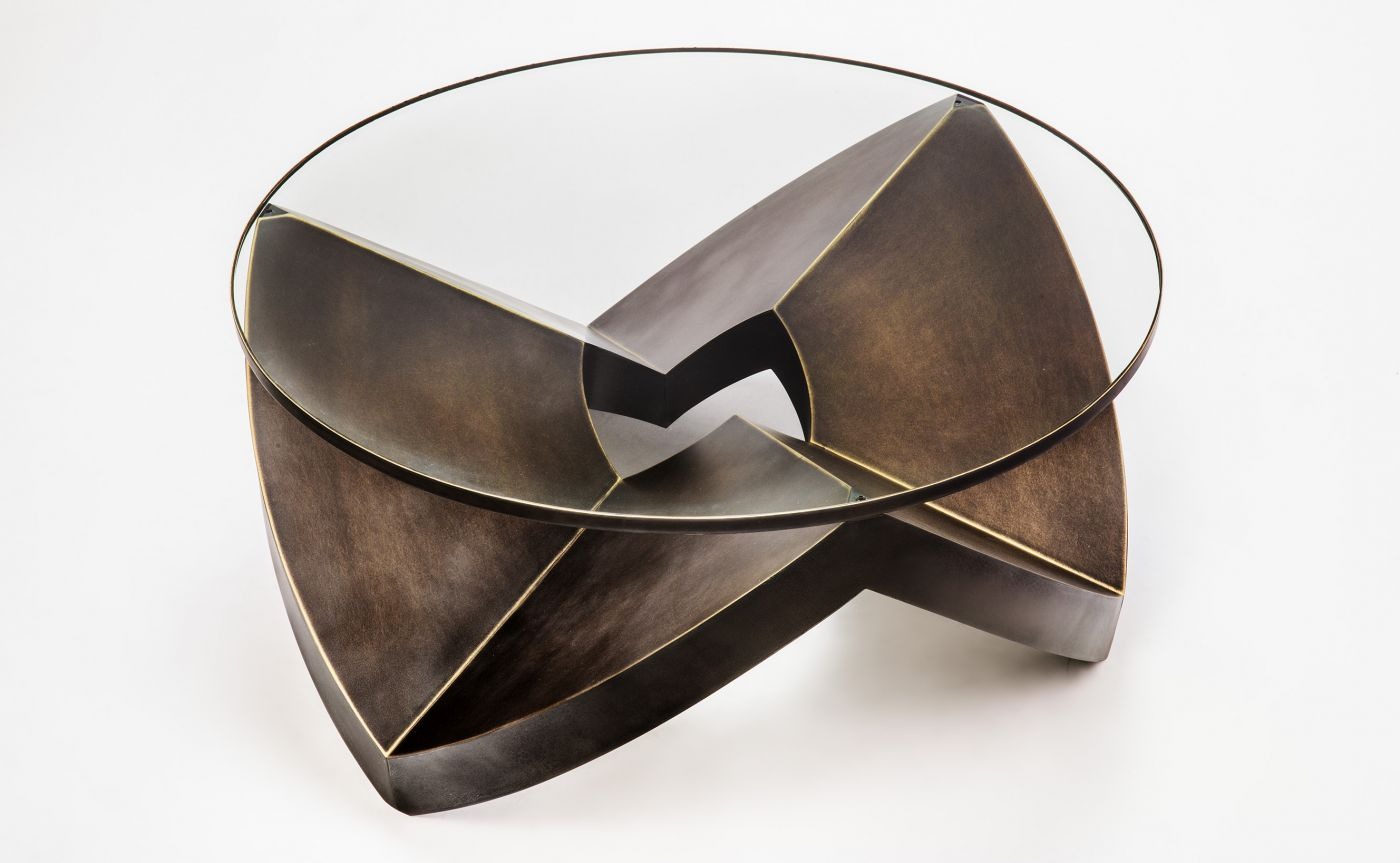 garrido gallery New Garrido Gallery's Collectible Designs at The Salon Art+Design PEAKS ROUND LOW TABLE IN BRONZE ANTIQUE FINISHING WITH GLASS
